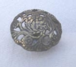 Antique brass effect metal button
