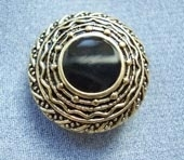 Antique gold metallic button