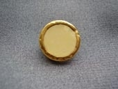 Gilded metal rim button