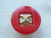 Dyed button, metallic effect centre