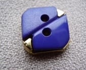 Dyed, metallic insert button