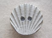 Metal effect shell button