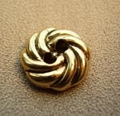 Gilt metallic finish button