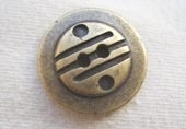 Brass effect metal button