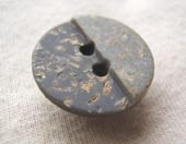 Mock granite button