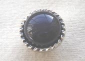 Black domed button nickel rim
